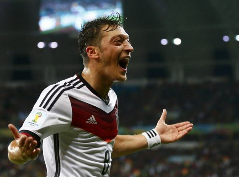 Germany's Mesut Ozil celebrates scoring their second goal during extra time in their 2014 World Cup round of 16 game against Algeria at the Beira Rio stadium in Porto Alegre June 30, 2014. Photo credit: Reuters