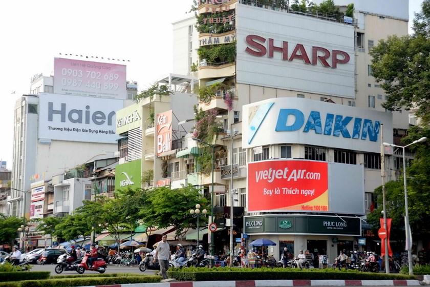 Advertising billboards at a street corner in Ho Chi Minh City downtown. Photo: Diep Duc Minh