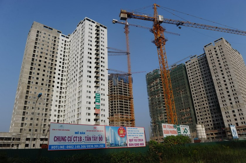 Billboards offering the sale of apartments outside unfinished residential buildings on the outskirts of Hanoi. Vietnam finance supervising commission has reported little growth at construction sector this year, intepreting that as property market turmoil