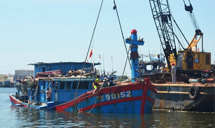 A Vietnamese fishing boat is lifted out of the water at a shipyard in the central coastal city of Da Nang June 2, 2014 after being sunk by a Chinese ship. The boat is reportedly the first to be sunk since China deployed an oil rig off Vietnamese central c
