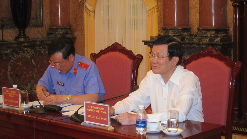 Vietnamese President Truong Tan Sang (R) at a meeting with the country's top prosecutors in Hanoi July 8, 2014. Photo: Thai Son