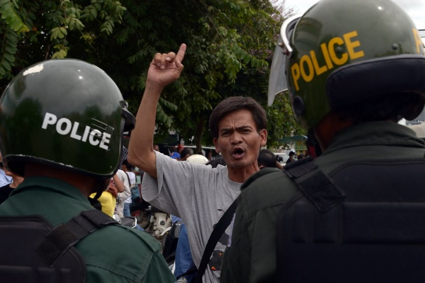 A Cambodian protester shouts slogans during a protest in front of the Vietnamese embassy in Phnom Penh on July 8, 2014. Photo credit: AFP