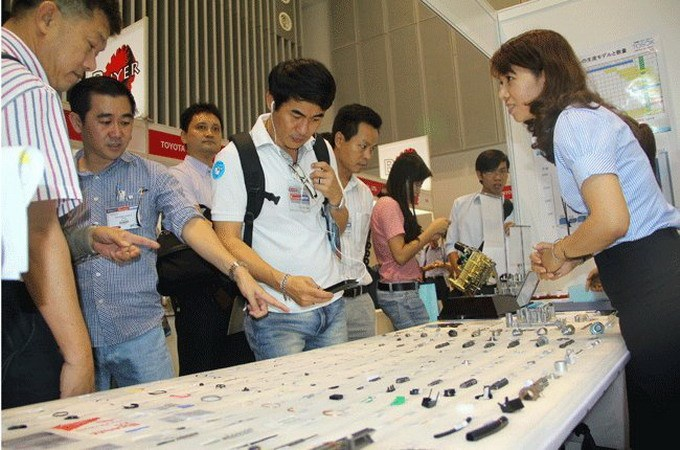 Visitors check for accessories displayed at a supporting industries exhibition in Ho Chi Minh City. Photo credit: TBKTSG