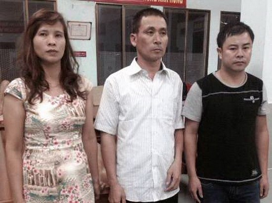 L-R: This photo provided by Ho Chi Minh City police shows Pham Thi Hang, Chu Hai Hung and Ho Sy Hieu detained after filing fake documents for immigration to the US