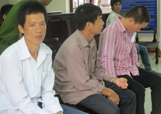 (L-R) Tran Van Hieu, Mai Van Vien and Nguyen Trung Tien at a trial in Ba Ria-Vung Tau Province July 24, 2014, as they were sentenced for smuggling people to Australia. Photo: Nguyen Long