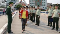 An undated photo show Vietnamese police receive trafficking victims from China at the border.