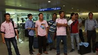 Vietnamese workers arrive at Tan Son Nhat Airport in Ho Chi Minh City after an evacuation flight from Libya on August 9, 2014. Photo credit: Phu Nu Newspaper