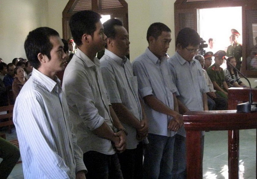 Five former police officers in Phu Yen Province stand at an appeal trial July 9, 2014 as prosecutors called for harsher punishment on their fatal beating of a theft suspect in May 2012. Photo: Duc Huy