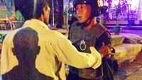A photo taken by a Gia Lai Province local captured one of the two traffic policemen (R) who allegedly chased three motorists and caused one of them to die. Photo credit: Tien Phong