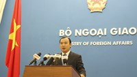 Le Hai Binh, the spokesperson of Vietnam's Foreign Ministry, speaks against recent Chinese boat attacks around Vietnamese islands at a press briefing August 21, 2014. Photo: Le Quan
