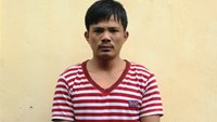 Le Van Tao, 27, at a district police station in Nghe An Province. His family turned him in for participating in the drunken assault of two plain clothes traffic cops on August 24, 2014. Photo: Canh Phuc/Tuoi Tre
