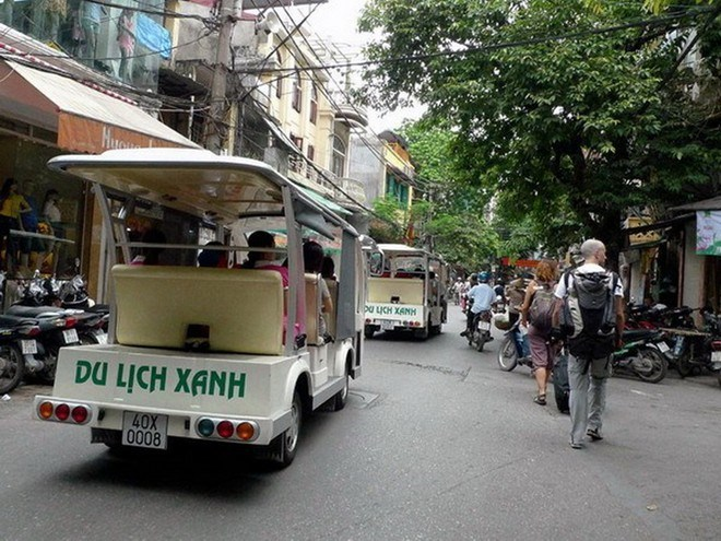 Electric cars take tourists through Hanoi's Old Quarter. Photo credit: Vietnam News Agency