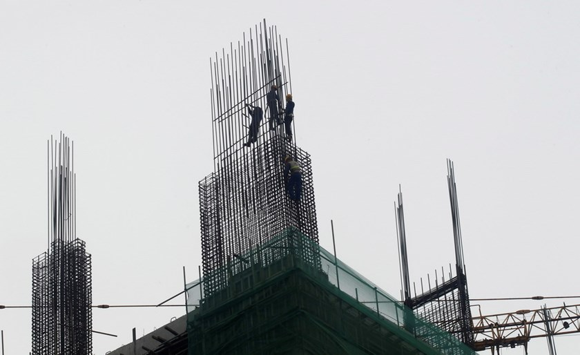 A construction site in Hanoi. Local steel firms are expecting an early end of their business as the government considers allowing Russia to export steel at zero tariffs in Vietnam. Photo: Kham/Reuters