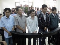 Five police officers in Phu Yen Province on trial on April 3, 2014 for beating a burglary suspect to death. Photo: Duc Huy