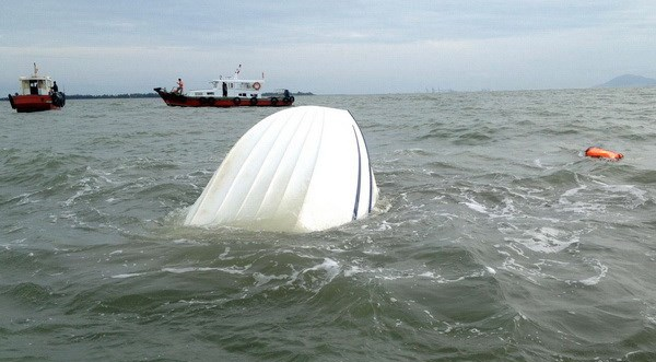 A coast guard boat that capsizes off the coast of Ho Chi Minh City in early August, 2013. Photo credit: Vietnam News Agency