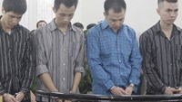 Four former Hanoi police officers in the dock during the two-day trial that ended on September 18, 2014. They were sentenced to between 8 and 17 years for beating a suspect to death during interrogation. Photo: M.Sang