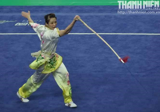 Duong Thuy Vi, 21, dance with a lance at a wushu performance that won Vietnam a gold at the Asian Games in Incheon, South Korean on September 21, 2014. Photo: Quang Tuyen