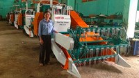Phan Tan Ben, director of an agriculture firm in Dong Thap Province, stands by his company's combine harvesters which have been sought after by buyers in Myanmar and Tanzania. Photo credit: Dong Thap news portal