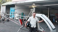 Bui Hien and his helicopter, which he expects will be used for agriculture and rescue activities. Photo: Do Truong