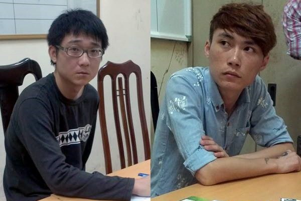 Two Taiwanese arrested in Ho Chi Minh City on June 30, 2014, as members of a Taiwanese syndicate that involved making fake official phone calls to cheat victims' money. Photo credit: Vietnam News Agency