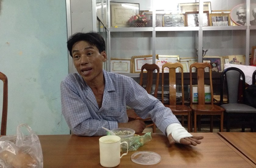 Dang Van Tuan, 44, tells officers at a Ho Chi Minh City police station how and why he killed and dismembered his de facto sister-in-law. Photo: Dam Huy