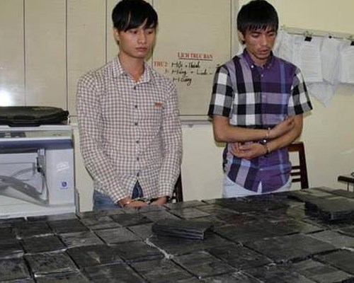 Two of the four traffickers that Son La Police arrested on October 1, 2014 for trafficking more than 53 kilograms of heroin. Photo: Trung Do
