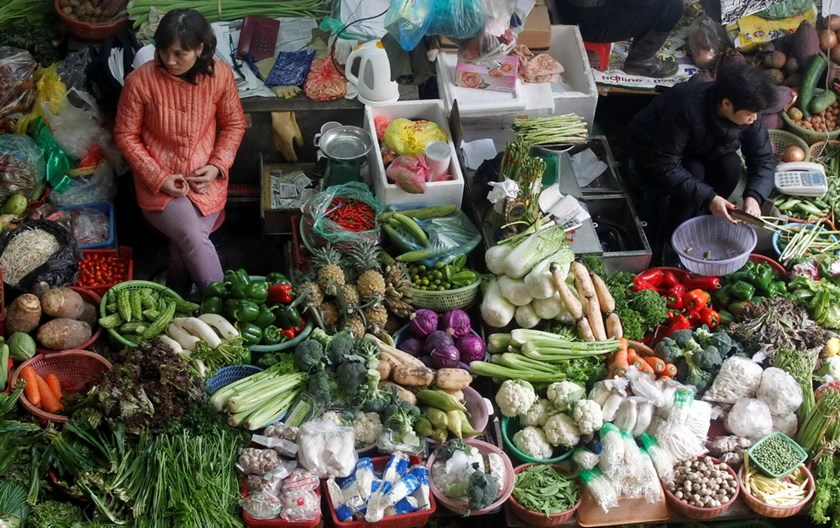 Vegetable sellers in Hanoi. Vietnam has halted export of vegetables to the EU to avoid an export ban after the bloc flagged its third shipment since February 1 2014. Photo: Kham/Reuters
