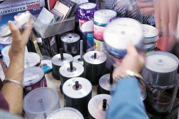 Disks of pirated software are widely available in Vietnam's markets. Photo credit: Livemint
