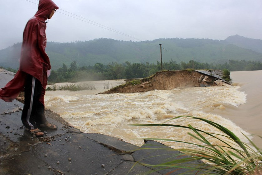 A man looks out on a ruptured irrigation reservoir in Thanh Hoa Province after downpours in October 2013. Photo: Ngoc Minh