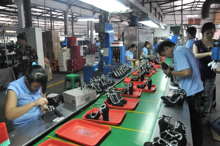 Shoe factory workers in Ho Chi Minh City. Opportunities to expand Vietnam's footwear industry will be huge, especially after the passage of the Trans-Pacific Partnership Agreement (TPP), experts say. Photo: Diep Duc Minh