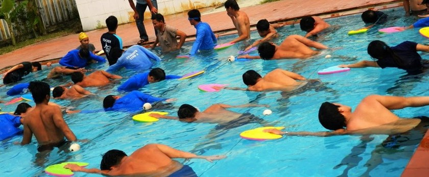 Vietnamese adults being trained as swim teachers in a photo provided by Swim Vietnam, a charitable swimming club founded by Scottish national Joanne Stewart and based in the flood-prone province of Quang Nam.