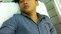 Tran Trong Long, 14, was taken in for medical treatment after the police chased him and an accomplice for snatching a person's iPhone on the street in Ho Chi Minh City on November 26, 2014. Photo: Duc Thanh/Tuoi Tre