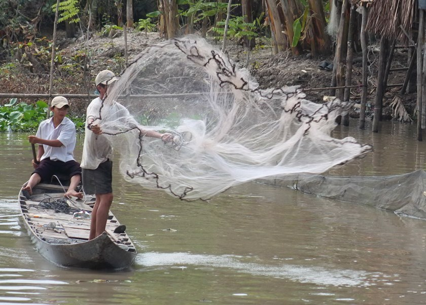 Men are fishing in Vietnam's Mekong Delta. Photo: Tien Trinh