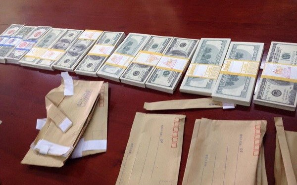 Fake dollar notes seized by police in Lang Son Province on November 28, 2014. Photo credit: Lao Dong