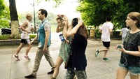 Tourists walk through a Hanoi street listening to the Echoes sound map app. Photo supplied