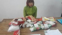 Nguyen Thi Ha with bags of meth she allegedly smuggled from China at a Quang Ninh border guards' station on December 14, 2014. Photo: Le Tan