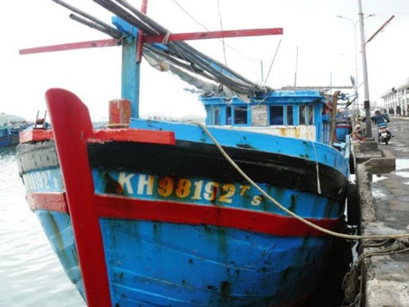 A Nha Trang fishing boat anchors in its home port after returning from a pirate attack on December 2, 2014. Photo: Hien Luong