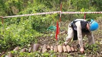 Workers hit bombs, bullets while building school in southern Vietnam
