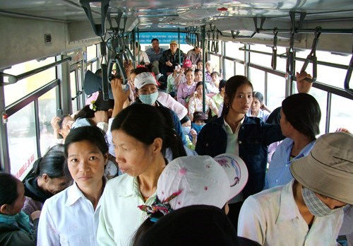 Female commuters on a public bus in Hanoi. Thirty-one percent of female students said they had been sexually harassed on public busses. Photo: Ngoc Thang