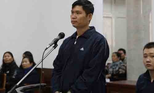 Nguyen Manh Tuong stands in a Hanoi courtroom on December 4, 2014. Photo: Ha An