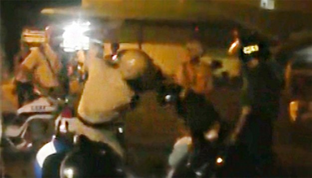 A scene from a YouTube video of a fight between police and two men in Soc Trang Province.