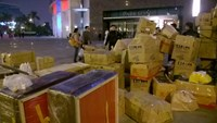 Retailers scrambling to move cardboard boxes as they are forced out of the Parkson Landmark Tower in Hanoi on January 3, 2015. Photo: Le Quan