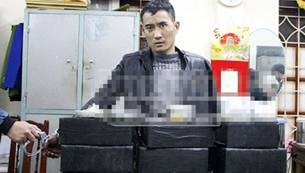 Tran Duc Duy has been arrested for allegedly driving a truck of heroin from Hoa Binh Province to Hanoi. Photo credit: An Ninh Thu Do