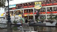 Foreign tourists wait across a restaurant boat at Bach Dang Wharf in Ho Chi Minh City. Photo: Son Cao