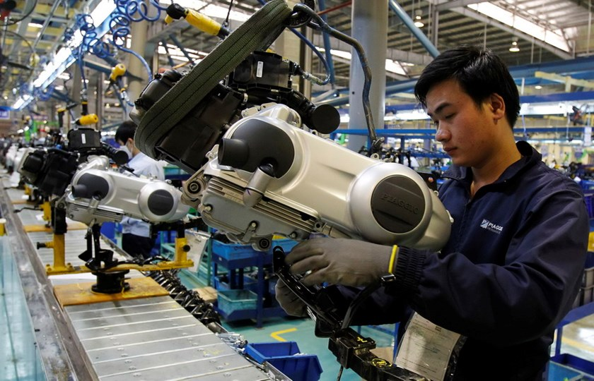 The assembly line at a Piaggio scooter factory in northern Vietnam. Photo: Kham/REUTERS