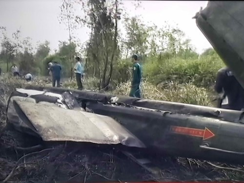 A screen capture from Quoc Phong Viet Nam television channel shows the damaged tail boom of a Vietnam's Air Force helicopter after it crashed in Ho Chi Minh City on January 28, 2015.