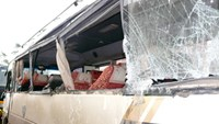 A passenger bus is damaged in a collision with a military truck in Thanh Hoa Province on February 4, 2015. Photo credit: Kien Thuc