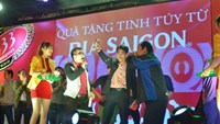 Guests are invited on stage at Nha Trang gymnasium to receive beer giftetd by their friends through a Sabeco program on January 25, 2015.