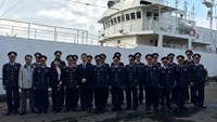 Vietnamese coast guards take photo with a patrol ship gifted from Japan on February 5, 2015. File photo