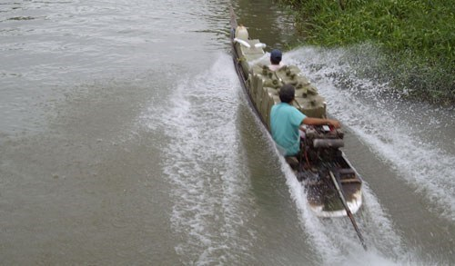 A boat carrying tobaccos smuggled from Cambodia travels on a canal in the Mekong Delta province of Long An. Photo: Hoang Phuong